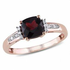An elegant classic, this vintage-inspired gemstone and diamond ring is a thoughtful choice for her January birthday. Crafted in precious 14K rose gold, this alluring design features a 7.0mm cushion-cut regal red garnet wrapped in a frame of sparkling diamonds and intricate milgrain detailing. Additional diamonds line the ring's slender shank. With heirloom appeal, this ring captivates with 1/8 ct. t.w. of diamonds and a bright polished shine. This ring is available in size 7 only.