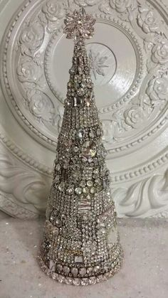 I'm going to make a tree like this with plastic jewelry from the thrift store.