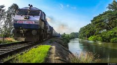 The Kaveri Express passes by the Kaveri River....