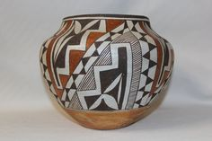 Vintage Pottery Description: Ca. Vintage polychrome pottery olla with striking geometric motif. Good overall condition and nice patina for its age, has some minor dings and pits. Native American Baskets, Native American Pottery, Native American Indians, Outside Fire Pits, Fire Pots, Cultural Artifact, Styling Brush, Pueblo Pottery, Bright Background