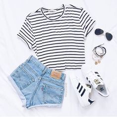 Black • White Striped Cropped Tee Only worn a few times, great condition! Very cute with high waisted shorts or a high waisted skirt! Measures 14 inches from should to hem. Tight fit. Not Tobi- listed for exposure Tobi Tops Crop Tops