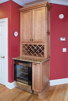 Warm Family Kitchen Remodel In Marietta - Fabulous custom kitchen wine center by AK! http://www.AKAtlanta.com