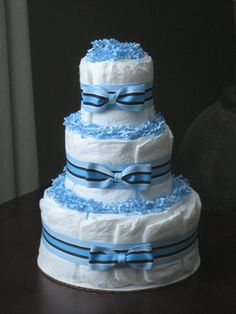 I have made this diaper cake for several showers.  I like to add all little baby accessories like rattle, soother, socks, hat, mitties etc.