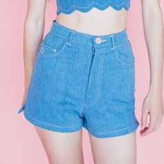 adorable high-waisted denim short shorts • high-waisted denim • super short fit • pale pink stitching • embroidered heart detail on pocket • pink button detail • pale pink back pocket detail • zip fly closure • 100 % cotton • perfect condition • by nyc boutique designer samantha pleet • Urban Outfitters Shorts Jean Shorts