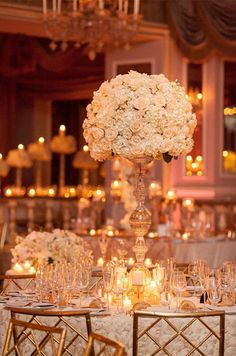 A tall centerpiece of white roses lends an elegant feel to this reception space.