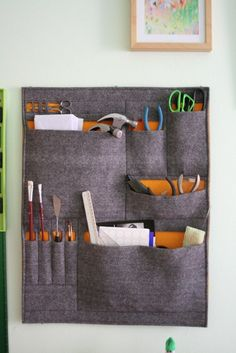 Will probably need to craft a lovely felt organizer like this for my sewing nook...