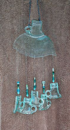 recycled jug wind chime- so cute with the tops of the jars as the chimes!