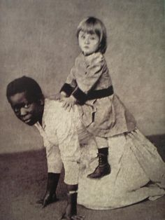 "Slave serving as a ""horse"" for white child."