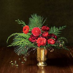 Holiday Flower Arrangement | Bring classic Christmas cheer to your holiday table with this bold bouquet. Learn how to make it step-by-step.