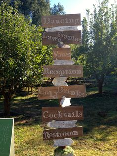 Use reclaimed wood and create directional signs for your guests at the wedding.