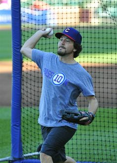 Singer Eddie Vedder practices before throwing out the ceremonial first pitch in a game between the Chicago Cubs and the San Diego Padres on July 24, 2014 at Wrigley Field in Chicago, Illinois. Check out celebs spotted at Wrigley Field! http://celebhotspots.com/hotspot/?hotspotid=24198&next=1