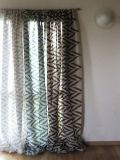 drape on the left  an example of how your living area curtain may look in the rubik mineral fabric...