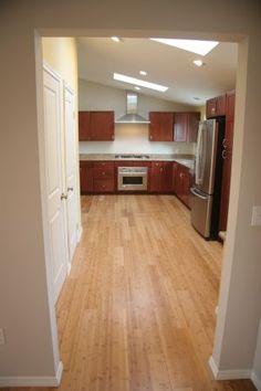 Kitchen, skylights, laminate wood flooring.