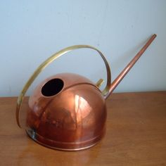 Copper watering can.