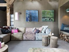 Rustic bohemian converted farm house. Lusting over that tie dyed sectional lounge and those tree stump side tables. Rustic/industrial feel.