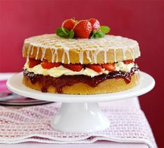 Strawberry & mint afternoon tea cake  Crank up the flavour of a classic Victoria sponge sandwich with a hint of mint, clotted cream icing and fresh fruit