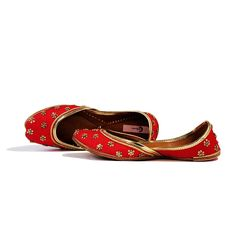 A beautifully ornamented hand embroidered juttis made with red silk base adds…