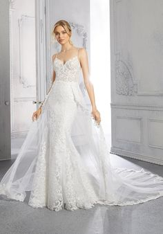 This fit and flare, net wedding dress has a sweetheart, v-neckline and spaghetti straps. Affordable Wedding Dresses, Bridal Wedding Dresses, Designer Wedding Dresses, Bridesmaid Dresses, Pageant Dresses, Quinceanera Dresses, Fit And Flare Wedding Dress, One Shoulder Wedding Dress, Always And Forever Bridal
