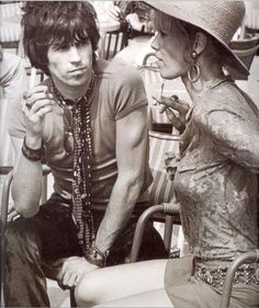 Keith Richards & Anita Pallenberg....the way he's looking at her. . . .