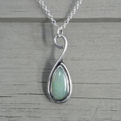 Sterling silver pendant with pale green jade teardrop shaped cabochon, $85.00