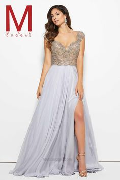 Platinum is the in color this season and this elegant prom dress features an easy way to show off the hottest trend. The illusion bodice and cap sleeves are completely covered with crystal and AB stones. A sexy v-neckline makes a serious style statement and a defined waistline creates a figure-hugging look. With a high-leg slit and a chiffon overlay skirt this prom dress is the ultimate spring style. In all three colors, this lovely dress looks perfect on the red carpet and a