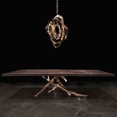"THE ""GROLIER"" TABLE Design by Barlas Baylar Seamed Walnut top, Black Lacquer top Statuary Bronze Base"
