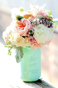 A minted bottle and romantic pink florals = happy match. 15 Centerpieces For…
