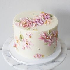 Pink buttercream flower cake