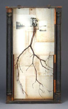 Dead To The World (clock cabinet, cedar branch, cast metal figurine, photographic prints, book pages) 2004, James Michael Starr