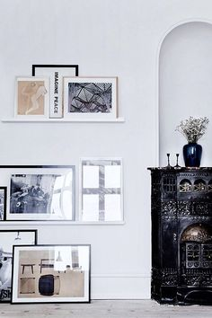 Framed artwork at all different heights, frame styles, and layers.