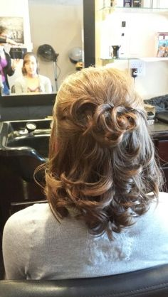 Half updo on medium length hair with lots of layers.