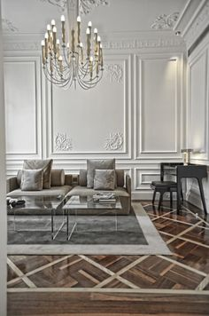 Love the panelled walls and parquetry floors....very stylish and a look that lasts forever