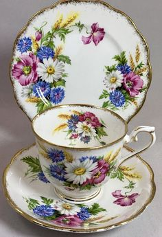 "Royal Albert Harvest Bouquet Trio, Teacup Saucer and Dessert Plate This lovely hard to find Trio is in excellent condition Sharp Vivid Colours trimmed in gold gilt. Gold gilt in excellent condition Measures Teacup opening: 3.25"" Including handle: 4.4"" Saucer: 5.5"" Plate: 6.3"""