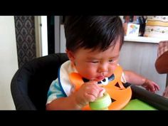 Baby Bowan Eating  Watermelon with Ulubuluu silicone bib, in Inglesia Table Fast chair and Summer Infant Tiny diner place mat with watermelon in Shoppers Drug Mart Life brand baby food feeder.