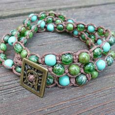 Three Shades of Green Wrap Bracelet - Brown Hemp Macrame Bracelet, Green Glass Beads, Brass Sunburst Button, 3x Wrap. $16.00, via Etsy.