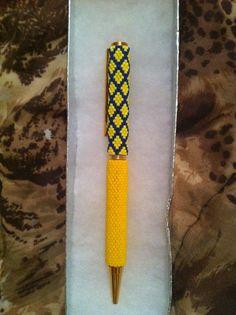 Handmade yellow and purple peyote pen