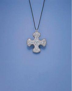 A double faced diamond, tsavorite garnet and sapphire cruciform by JAR  Magnificent Jewels Christie's -sale 1255 18 November 1998 #LucDanto via JLF