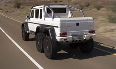Mercedes-Benz AMG63 6x6 has a transfer case with a 0.87:1 high-range ratio and 2.16:1 low-range ratio for off-road conditions to all six wheels in a 30:40:30 split. The power to the rear-most axle is by way of an extra drive shaft. There are five electronic differential locks offering 100 percent lockup of all six wheels, operated by three switches on the dashboard. At the ends of each axle are the massive 37-inch wheels featuring a bead-plate design. They are shod with 12.5-inch-tires.