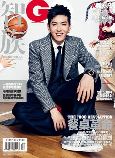 Kris Wu wearing a classically cut herringbone Chesterfield from the new Burberry collection on the October cover of GQ China
