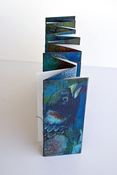 To Make the Portrait of the Bird (Collaboration work with Deer's Run Press 2007) by Margaret Suchland • 5.5 x 9.5 Double accordion structure. Digital prints tipped onto the main accordion structure with vellum pages containing text and commentary sewn into the valleys. Text and prints hand-sewn and bound in hand-dyed Stonehenge paper. Edition of 25.
