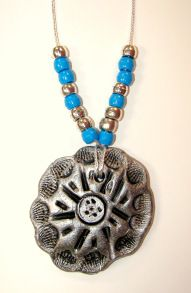 Native American jewelry made with model magic and metallic paints