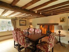 Prepossessing Oak Beams home interior design Farmhouse Dining Room South East home loans 17th Century Bespoke Lampshades English country Inglenook fireplace oak beams oak floors Thatched Cottage traditional upholstered dining chair - Decorcology.com