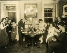 Alice Foote MacDougal entertaining a group of sailors in her small apt., ca. 1917-1918; photograph by Jessie Tarbox Beals. Jessie Tarbox Beals Photograph Collection, PR 004, Department of Prints, Photographs, and Architectural Collections, New-York Historical Society, 67535.