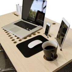 The Tech Desk is a unique, lightweight work desk that helps you stay organized. It includes display docks for your mobile devices, an air vent for your laptop, and a built-in mousepad, cup holder, pen dock, and filing rack. Made of premium bamboo, and hand-built in the USA.