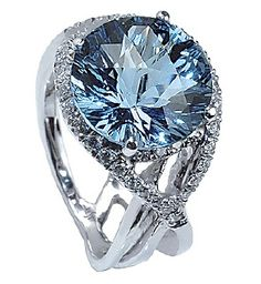 Mark Silverstein Blue Topaz and Diamond Gemstone Ring. The diamonds are G-H in color and VS in clarity. The ring is in 18k white gold.