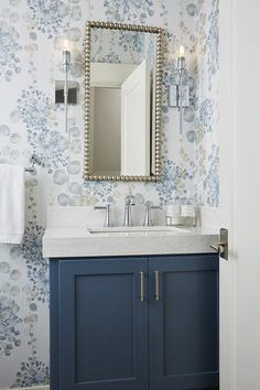 With a vibrant infusion of blues and a floral wallpaper this renovated powder room felt bright airy and contemporary. With a vibrant infusion of blues and a floral wallpaper this renovated powder room felt bright airy and contemporary. Blue Powder Rooms, Powder Room Decor, Powder Room Design, Small Powder Rooms, Powder Room Vanity, Powder Room Wallpaper, Bathroom Wallpaper, Bathroom Prints, Diy Bathroom Decor