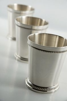 little mint julep cups $6.50/each--- this site has lots of glass vases and apothecary jars for cheap. Love!