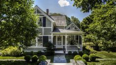 The spacious home sits on a half-acre plot of verdant land just steps away from the North Cove, with water-views to it and the Connecticut River.