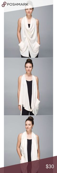 Lululemon tranquility wrap convertible vest Gently used (only because it's white otherwise I would say like new).  Lululemon tranquility wrap convertible vest. Angel white color. Size 6. Can be worn 3 different ways as pictured above. lululemon athletica Tops