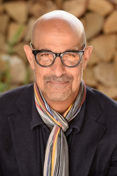 Stanley Tucci Photos - Stanley Tucci attends the RHS Chelsea Flower Show 2019 press day at Chelsea Flower Show on May 2019 in London, England. - RHS Chelsea Flower Show 2019 - Press Day Sharp Dressed Man, Well Dressed Men, Jacqueline Wilson Books, Bald Men Style, Best Mens Sunglasses, Older Mens Fashion, Stanley Tucci, Ways To Wear A Scarf, Mens Glasses